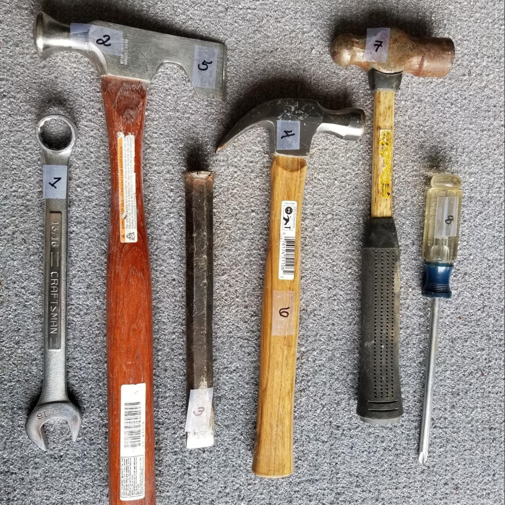 Assorted hand tools, numbered